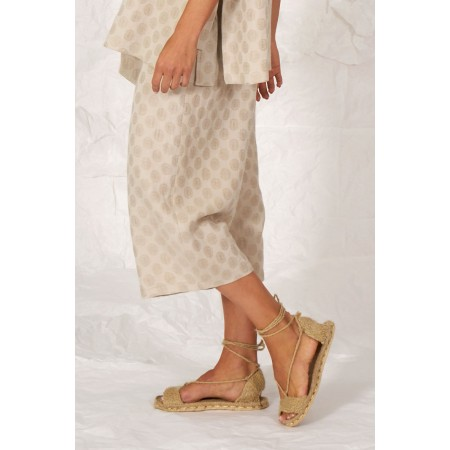 Beige linen and cotton moon printed Orsola pants.