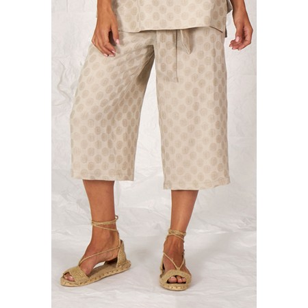 Beige linen and cotton moon printed pants.