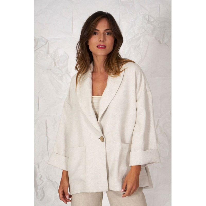 Beige wide jacket with tuxedo collar.