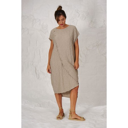 Beige dropped short sleeve dress with asymmetrical length.