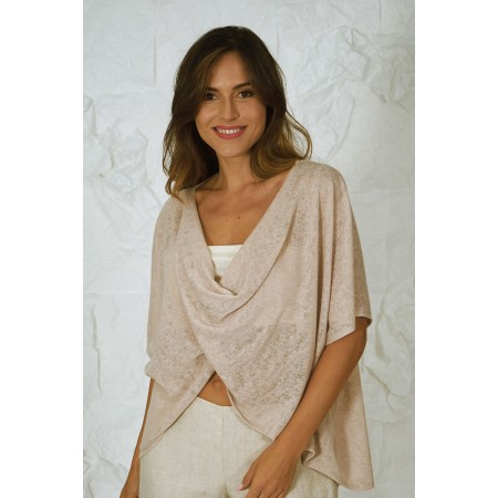 Beige short knit cardigan with a similar colour tank top.