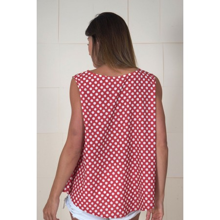 Pink print sleeveless blouse.