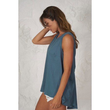 Blue knit sleeveless blouse with asymmetrical length.