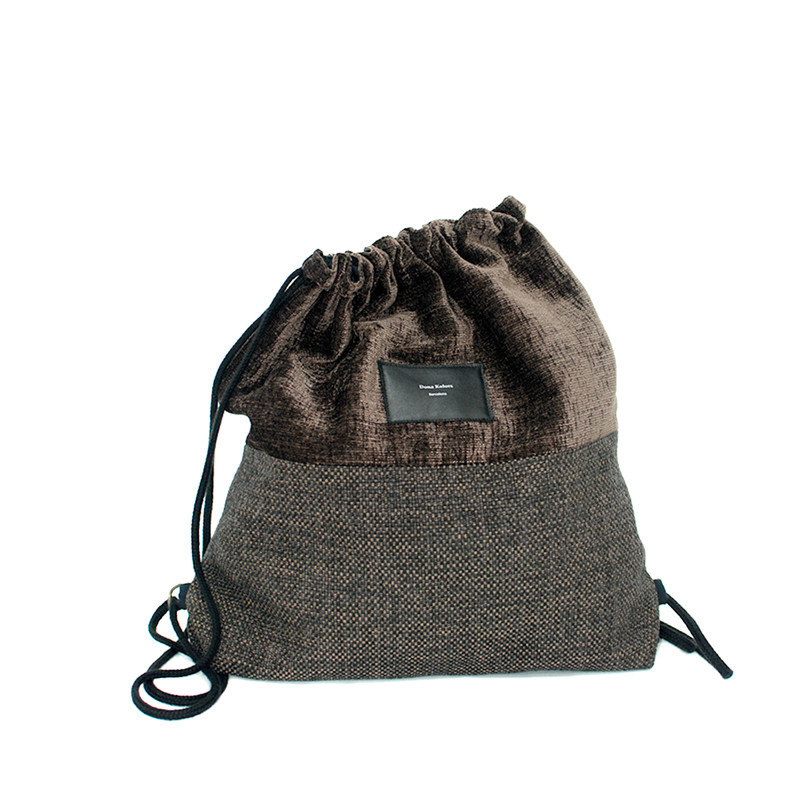 Brown upholstery backpack with inner lining and pocket