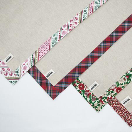 Conjunt d'estovalles individuals amb tovallonera de disseny nadalenc