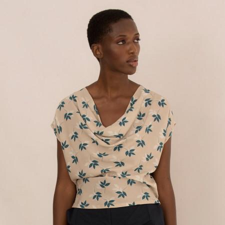 Beige leaves print blouse...