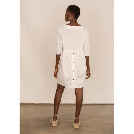 Vestit de lli blanc amb botons a l'esquena